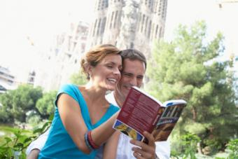 Tourists looking at travel guide