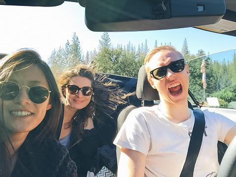Friends driving on road trip