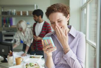 woman laughing at text message