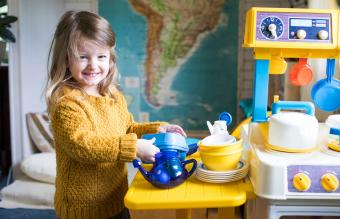 girl in her play kitchen