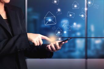 Business woman sending email