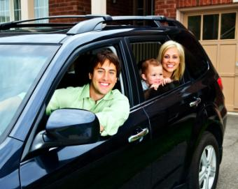 Family driving a SUV