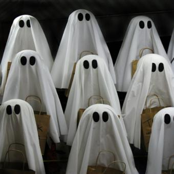 Nine funny sheet-covered ghosts