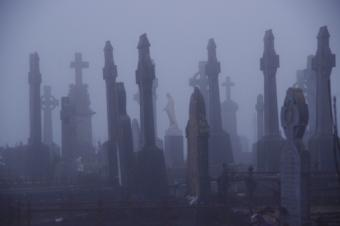 Scary graveyard monuments in the fog