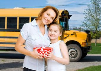 Mother giving daughter back to school gift
